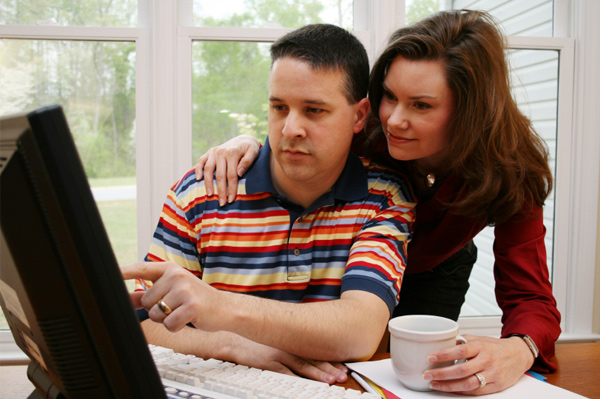 parents in front of laptop