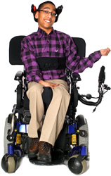 Young man using power wheelchair