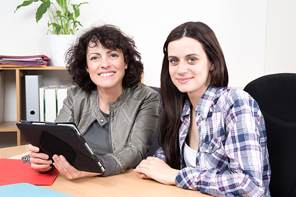 mother and daughter at desk